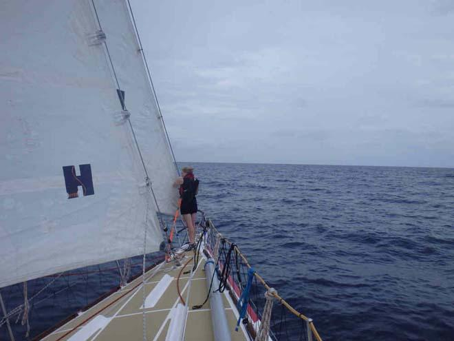 A crew member on the bow of PSP Logistics. - 2013-14 Clipper Round the World Yacht Race © Clipper Ventures