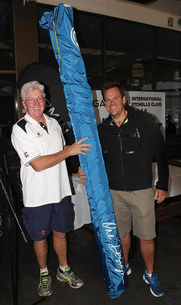 Roger Hickman receives his new jib from North Sails', Andrew Gavenlock. - Garmin NSW Etchells Championship photo copyright  John Curnow taken at  and featuring the  class