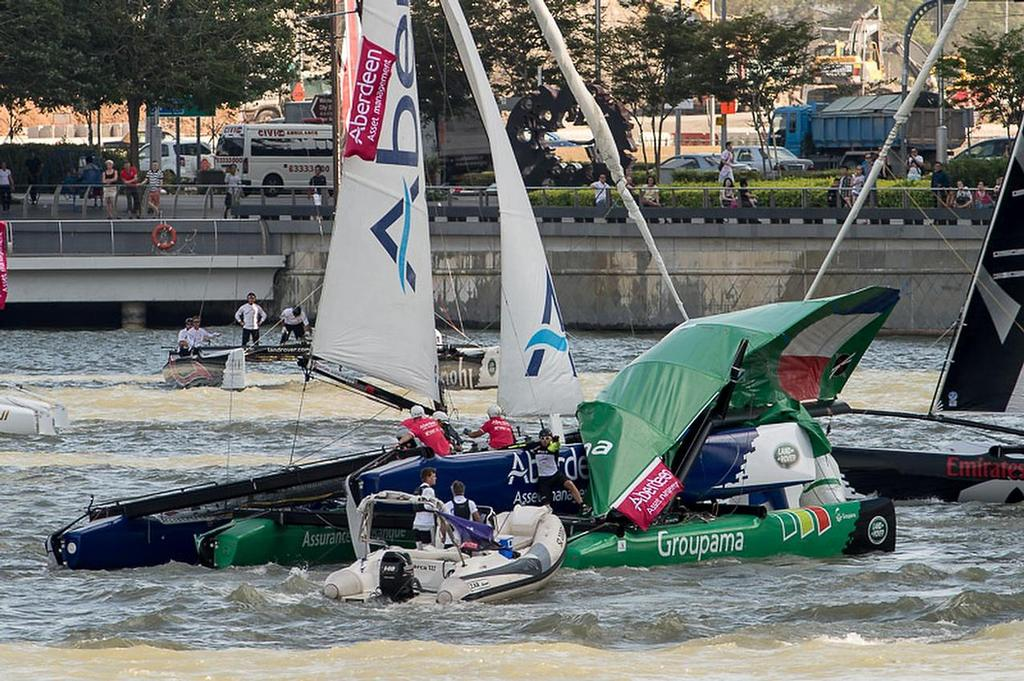 Team Aberdeen Singapore crashes down onto Groupama taking down the rig and injuring sailor Tanguy Cariou. Day three of the Extreme Sailing Series regatta being sailed in Singapore. 22/2/2014 © Chris Cameron/ETNZ http://www.chriscameron.co.nz