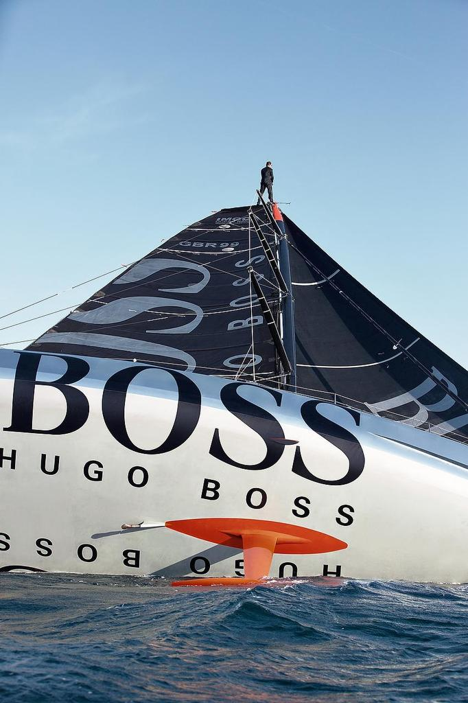 Pictures of Alex Thomson the skipper of the Hugo Boss IMOCA Open 60 race yacht walking up the mast of his yacht whilst sailing.<br />  &copy; Lloyd Images/Alex Thomson Racing