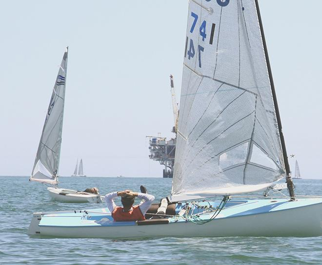 Andy Kern patiently waits for the wind that never arrived  - Finn Class North American Championships 2014 © Rich Roberts
