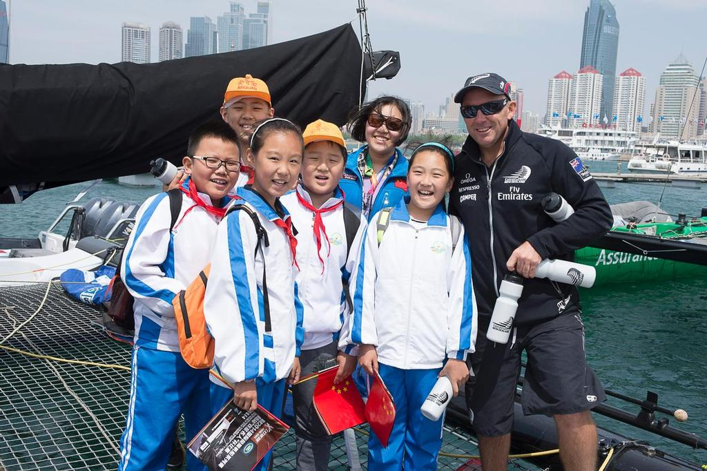 Emirates Team New Zealand's Ray Davies shows local school children over the team's Extreme 40. Day four of the Land Rover Extreme Sailing Series regatta in Qingdao, China. 4/5/2014 © Chris Cameron/ETNZ http://www.chriscameron.co.nz