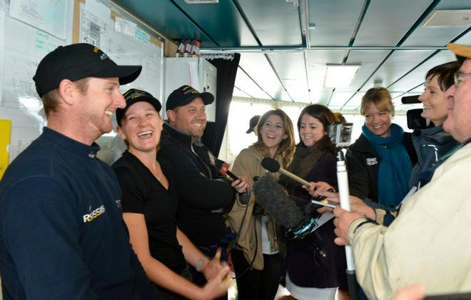 Django skipper Ben Costello with crewmates Bex Heikema and Andrew Cooke being interviewed on the bridge. - Django crew arrive ashore at Devonport Naval Base July 9, 2014 © New Zealand Defence Force