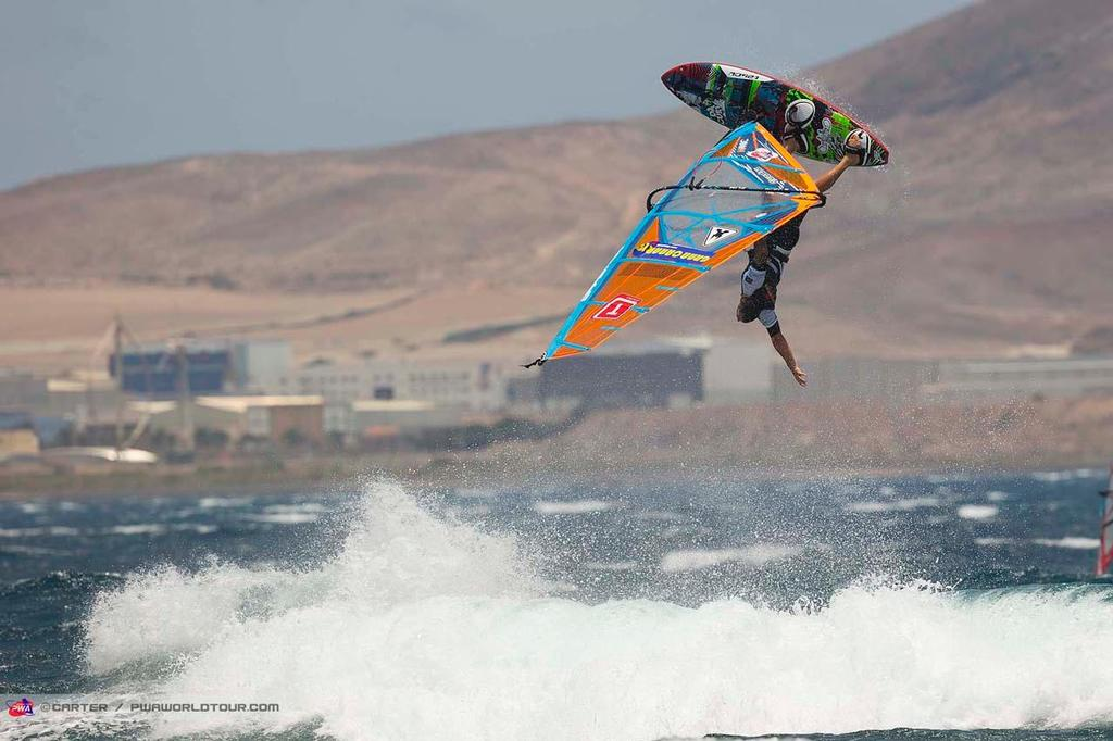 Ojeda one handed - 2014 PWA Pozo World Cup / Gran Canaria Wind and Waves Festival photo copyright  Carter/pwaworldtour.com http://www.pwaworldtour.com/ taken at  and featuring the  class