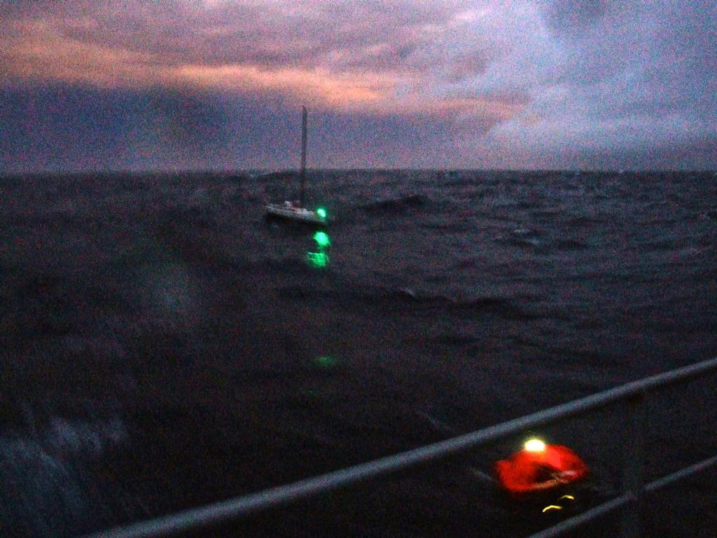 Liferaft nears ship in fading light © New Zealand Defence Force