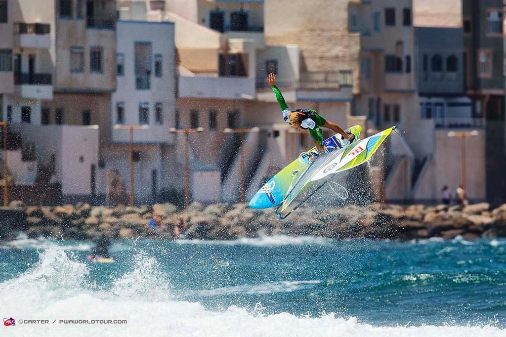 Trademark move for Alessio Stillrich - 2014 PWA Pozo World Cup / Gran Canaria Wind and Waves Festival ©  Carter/pwaworldtour.com http://www.pwaworldtour.com/
