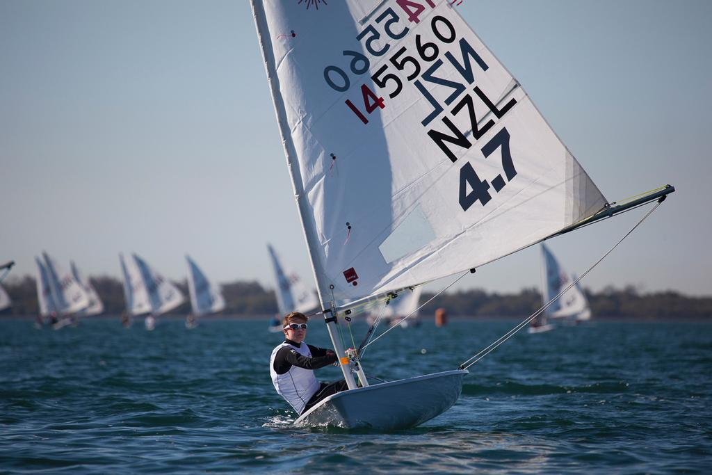 Grimwade leading a downwind leg in the light breeze on Day One. © Andrew Gough