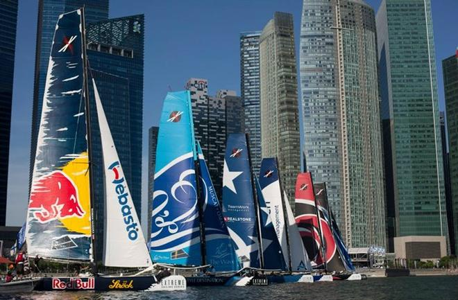 The fleet line up against the downtown city skyline for a race start in 2013 - Singapore. - Extreme Sailing Series © Lloyd Images