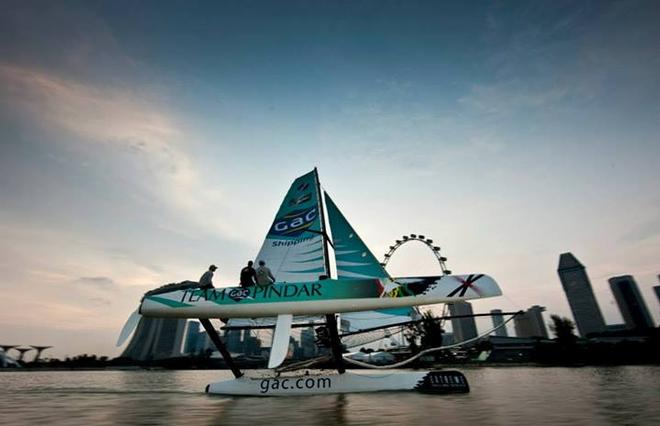 Team GAC Pindar inf ront of the world famous Singapore flyer, 2011. Extreme Sailing Series. © Lloyd Images