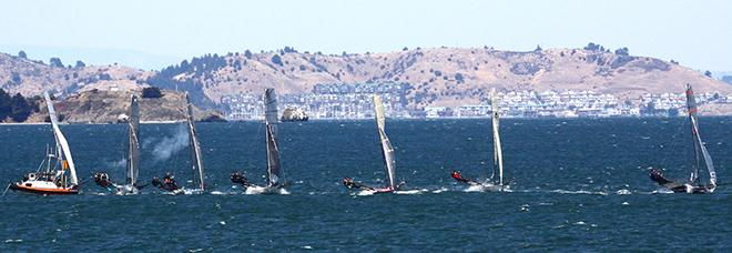 18' Skiffs sail through smoke from the starting gun in the middle of San Francisco Bay  - 2014 18' Skiff International Regatta © Rich Roberts