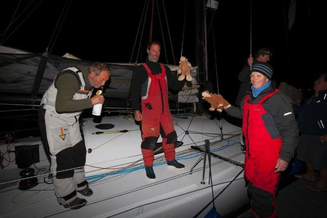 Welcoming Swish: Pippa, Monkey and Pippapotamus (L to R):Paul Pegg, Nick Legatt, Pippa Hutton Squire - Sevenstar Round Britain and Ireland Race 2014 © Patrick Eden/RORC