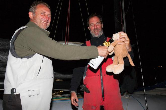 Swish's mascot takes a sip of Lanson too! L-R: Paul Pegg, Nick Legatt and Monkey - Sevenstar Round Britain and Ireland Race 2014 © Patrick Eden/RORC