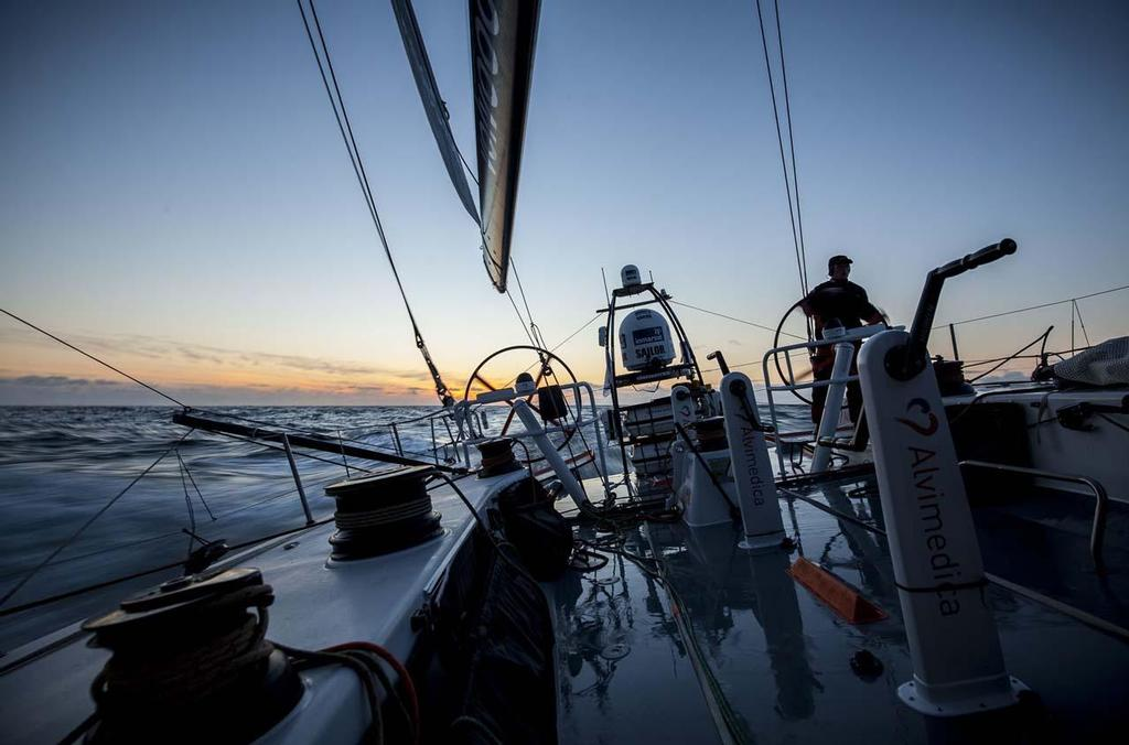 Matt Noble takes Alvimedica 4 back towards England in sunset solitude during the RORC's Round Britain and Ireland Race. ©  Amory Ross / Team Alvimedica