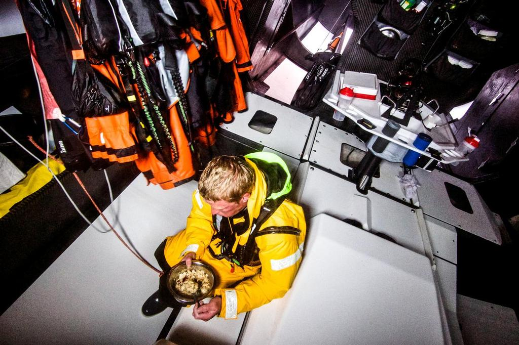 August 12, 2014. Round Britain Island Race Day 2 - OBR content Team Alvimedica: Matt Noble enjoys a quick meal by himself before heeding up for his four-hour watch on deck during day two of the RORC's Round Britain and Ireland Race. ©  Amory Ross / Team Alvimedica