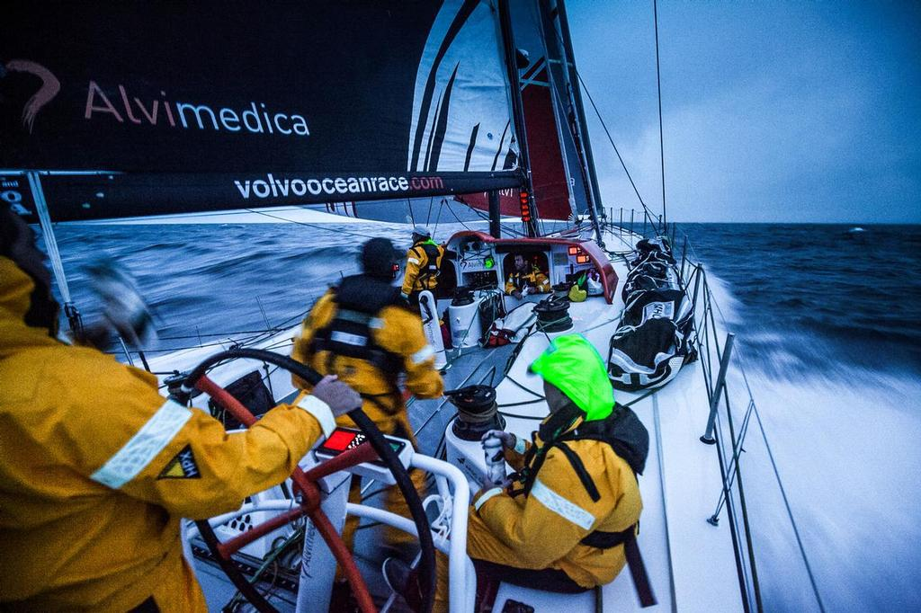 August 14, 2014. Round Britain Island Race Day 4 - OBR content Team Alvimedica: Alberto Bolzan drinks from his water bottle at the helm of Alvimedica after a sail change during the RORC's Round Britain and Ireland Race. ©  Amory Ross / Team Alvimedica
