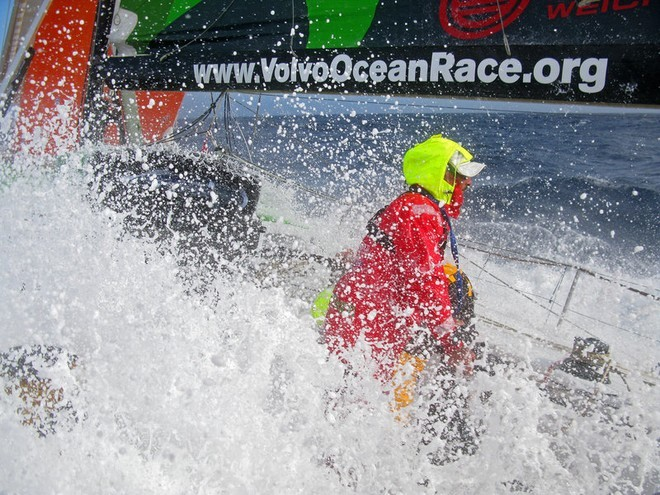 Waves wash across Green Dragon as Damian Foxall hangs onto the grinder pedestal during Leg 5 from Qingdao, China to Rio de Janeiro, Brazil.<br />  © Guo Chuan/Green Dragon Racing/Volvo Ocean Race http://www.volvooceanrace.org