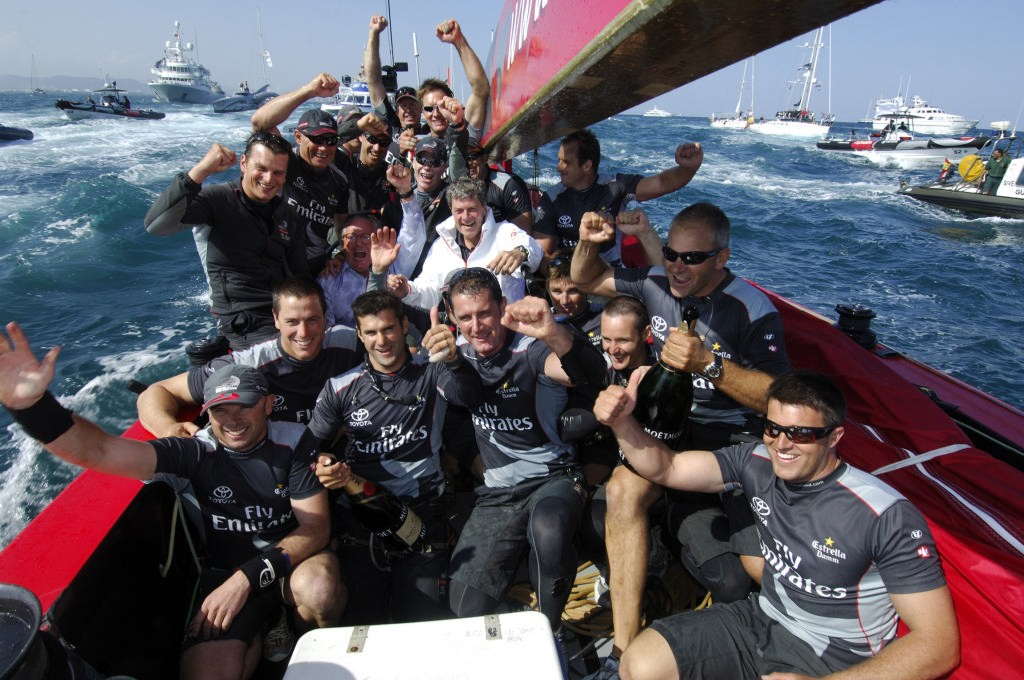 Emirates Team New Zealand crew celebrate with Yves Carcelle (white jacket, centre), the President and CEO of Louis Vuitton and Bruno Trouble aboard NZL92 after their 5 - 0 win of the Louis Vuitton Cup finals. 6/6/2007 © Emirates Team New Zealand / Photo Chris Cameron ETNZ