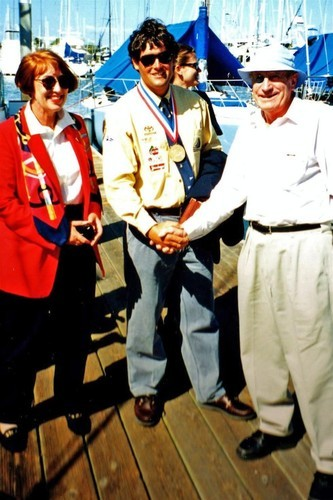 Hugh Poole and daughter congratulate Russell Coutts on his Gold medal win in the Finn class in 1984 © SW