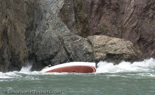 Savage Beauty on the rocks in San Francisco - she swings back side on in the next set of swells and drives into the rocks - the crew are still aboard. © Erik Simonson/ h2oshots.com