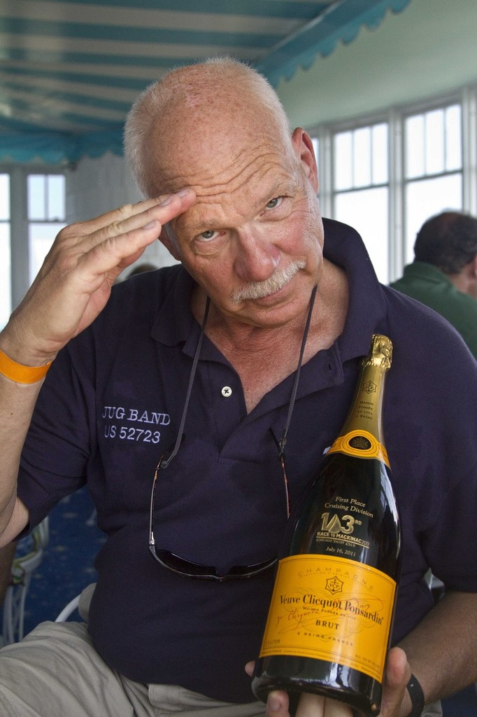 The captain celebrates with his fancy new bottle of Vueve Cliqout  - 103rd Race to Mackinac © Sean Palizza