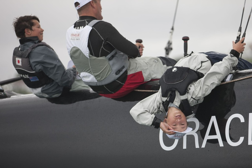 New Zealand national Optimist Champion, Leonard Takahashi-Fry on the handlebars of the AC45 © Gilles Martin-Raget/Oracle Racing.com http://www.oracleteamusamedia.com/