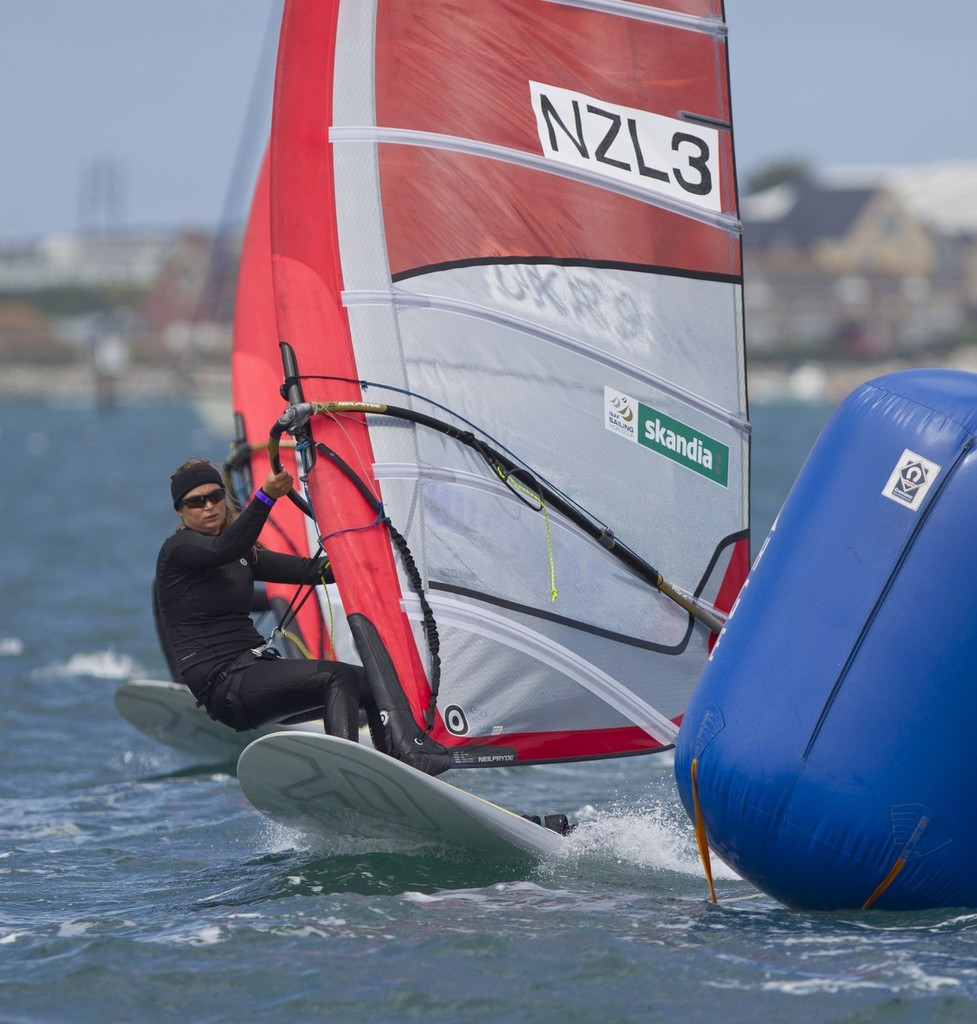 Steffanie Williams from New Zealand racing in the RSX Women class on day 2 of the Skandia Sail for Gold Regatta, in Weymouth and Portland, the 2012 Olympic venue.  © onEdition http://www.onEdition.com