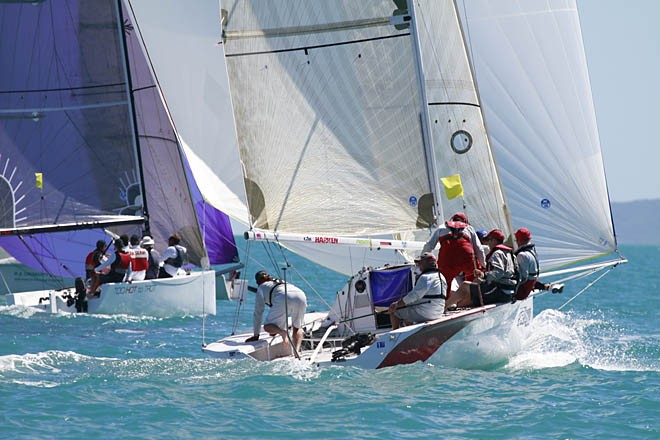 Too Hot Too Trot (purple Kite) and Stealthy - Airlie Beach 22nd Annual Race Week 2011 © Teri Dodds - copyright http://www.teridodds.com