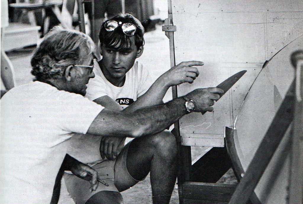 Alf Lock explaining a point during a measurement session in the 1977 OK Worlds © SW
