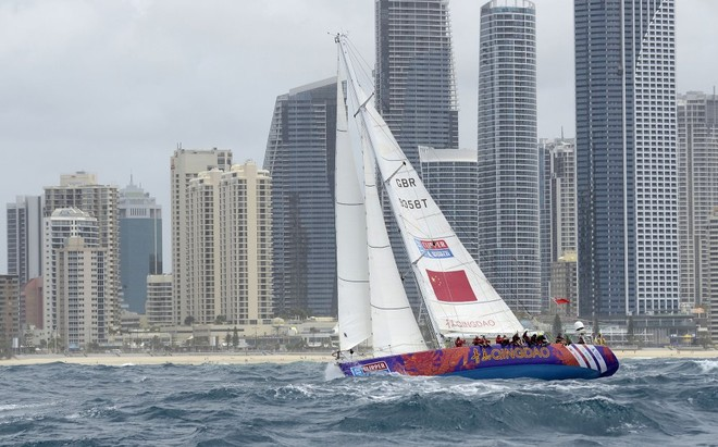 Qingdao races past Surfers Paradise at the start of the race from the Gold Coast to Singapore in the Clipper 11-12 Round the World Yacht Race. © Steve Holland/onEdition
