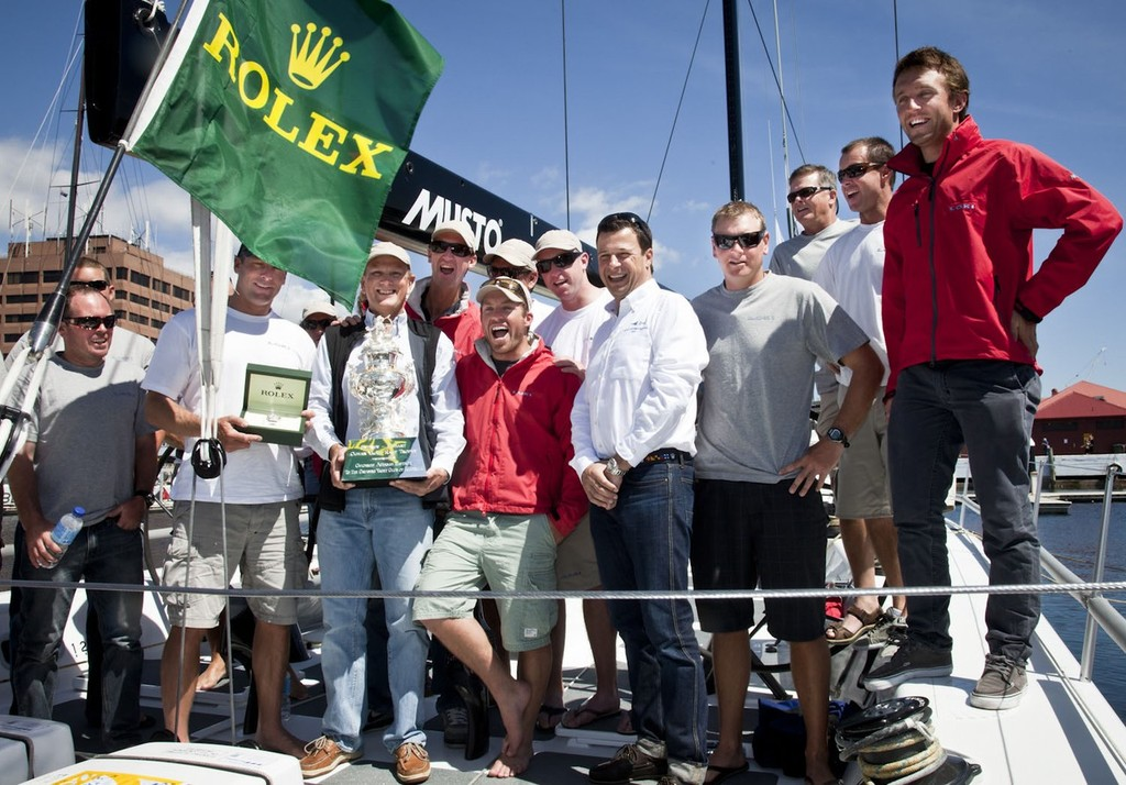 Loki crew are presented with Tattersall's Cup and Rolex Yacht-Master timepiece by Patrick Boutellier (Rolex Australia) and Commodores Graham Taplin (RYCT) and Garry Linacre (CYCA). ©  Rolex/Daniel Forster http://www.regattanews.com