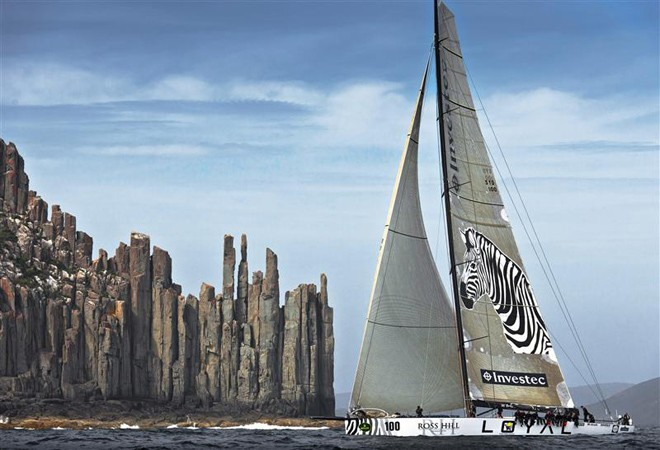 INVESTEC LOYAL passing Tasmania's iconic Organ Pipes at Cape Raoul - Rolex Sydney Hobart Yacht Race 2011 ©  Rolex/ Kurt Arrigo http://www.regattanews.com