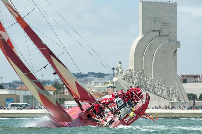 Camper with Emirates Team New Zealand passes Padrão dos Descobrimentos monument at the start of Leg eight from Lisbon, Portugal. Volvo Ocean race 2011-12.  © Chris Cameron/ETNZ http://www.chriscameron.co.nz