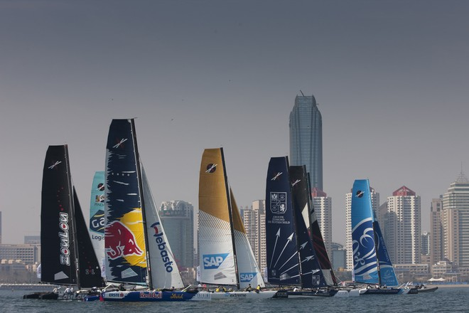 The Extreme 40 fleet racing in front of the impressive skyline in Fushan Bay, Qingdao - Act 2, Day 1, Extreme Sailing Series 2012 © Lloyd Images http://lloydimagesgallery.photoshelter.com/