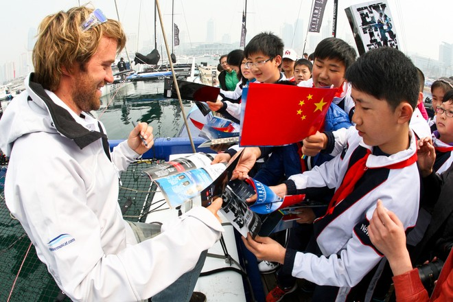 The Wave, Muscats Leigh McMillan meeting local Qingdao children - Extreme Sailing Series 2012 © QDYA