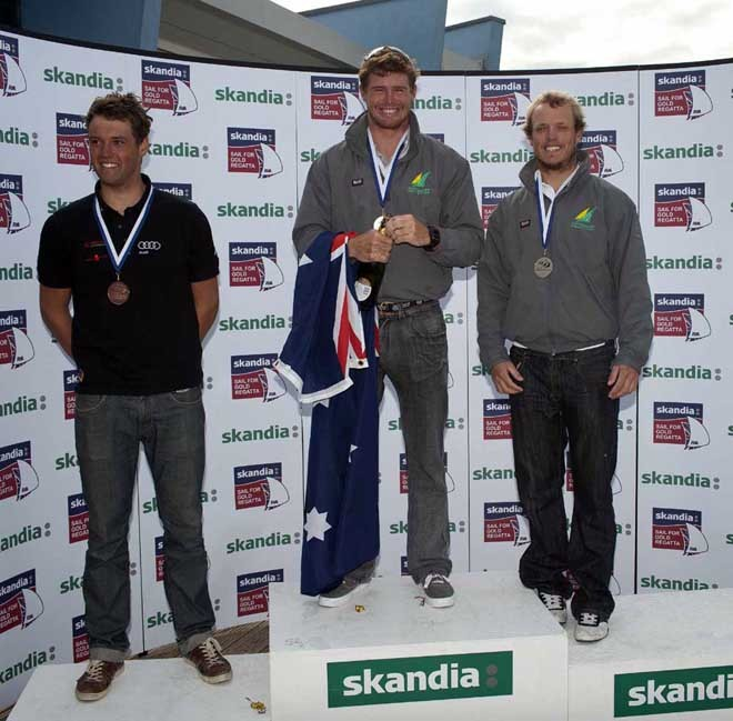 Tom Slingsby (AUS), Tom Burton (AUS), Philipp Buhl (GER) receives awards on Day 6 of the Skandia Sail for Gold Regatta, in Weymouth and Portland, the 2012 Olympic venue. © onEdition http://www.onEdition.com