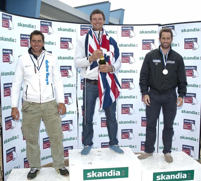 Giles Scott, Ben Ainslie (GBR), Pieter Jan Postma (NED), receives awards on Day 6 of the Skandia Sail for Gold Regatta, in Weymouth and Portland, the 2012 Olympic venue. © onEdition http://www.onEdition.com