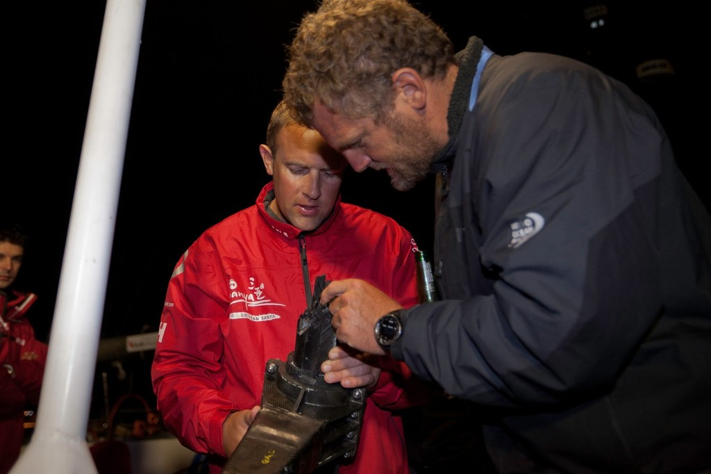 Richard Mason explains how the damage occurred the the broken rudder stock. Team Sanya skippered by Mike Sanderson from New Zealand, arrive in Tauranga, New Zealand, after a broken rudder and hull damage forced them to sail back, during leg 5 of the Volvo Ocean Race 2011-12, from Auckland, New Zealand to Itajai, Brazil. They are now forced to retire from leg five and miss leg six of the race and ship their race boat and equipment to Miami. (Credit: Gareth Cooke/Volvo Ocean Race) © Gareth Cooke/Volvo Ocean Race http://www.volvooceanrace.com