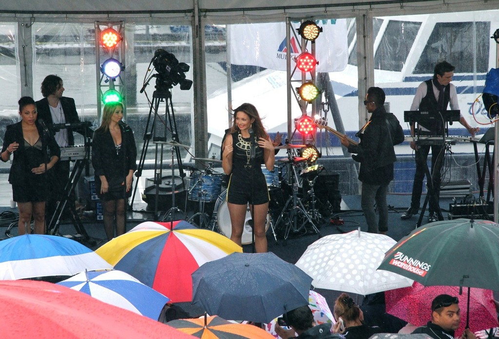 Fans crowd around the stage under a sea of umbrellas to watch Ricki-Lee perform © Rosalie Taylor