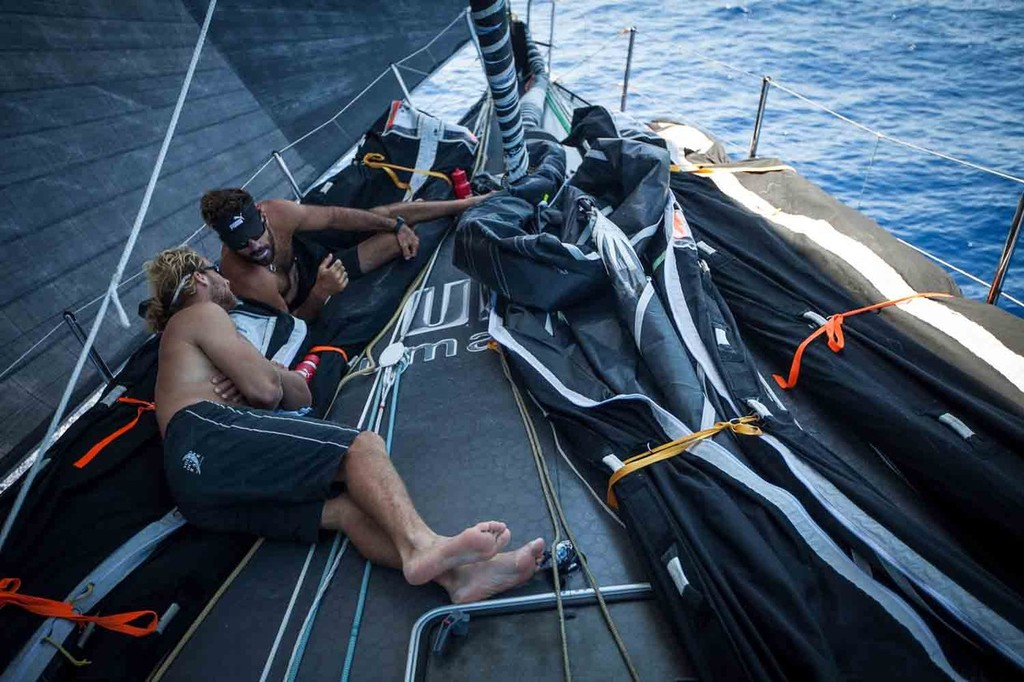 Michi Müller (close) and super-sub Shannon Falcone (far), both Puma veterans from the last race, find ample time to relax on the foredeck in the calm conditions, during leg 6 of the Volvo Ocean Race 2011-12, from Itajai, Brazil, to Miami, USA.  © Amory Ross/Puma Ocean Racing/Volvo Ocean Race http://www.puma.com/sailing
