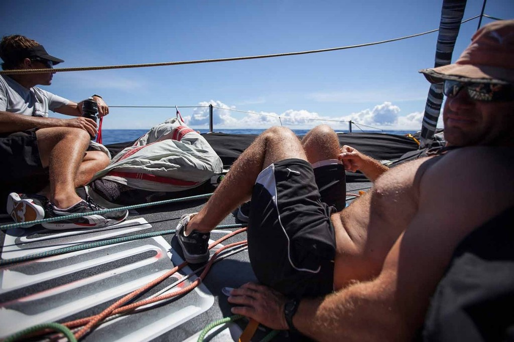 Kelvin Harrap and Ryan Godfrey relax on the sail-less bow during difficult drifting conditions. Onboard PUMA Ocean Racing powered by BERG during leg 6 of the Volvo Ocean Race 2011-12 © Amory Ross/Puma Ocean Racing/Volvo Ocean Race http://www.puma.com/sailing