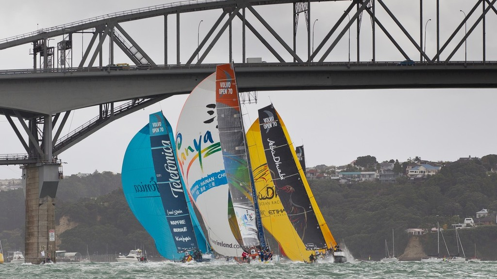 Team Telefonica, Team Sanya and Abu Dhabi Ocean Racing fly their spinnakers as they sail under Auckland Harbour Bridge, during the Auckland In-Port Race, in the Volvo Ocean Race 2011-12.  © Ian Roman/Volvo Ocean Race http://www.volvooceanrace.com
