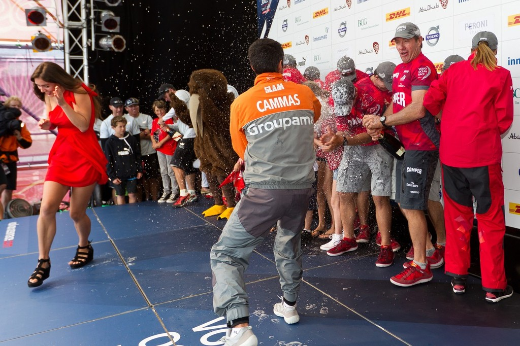 Groupama Sailing Team skipper Franck Cammas sprays champagne over winners CAMPER with Emirates Team New Zealand, skippered by Chris Nicholson from Australia, after the Auckland In-Port Race, during the Volvo Ocean Race 2011-12.  © Ian Roman/Volvo Ocean Race http://www.volvooceanrace.com