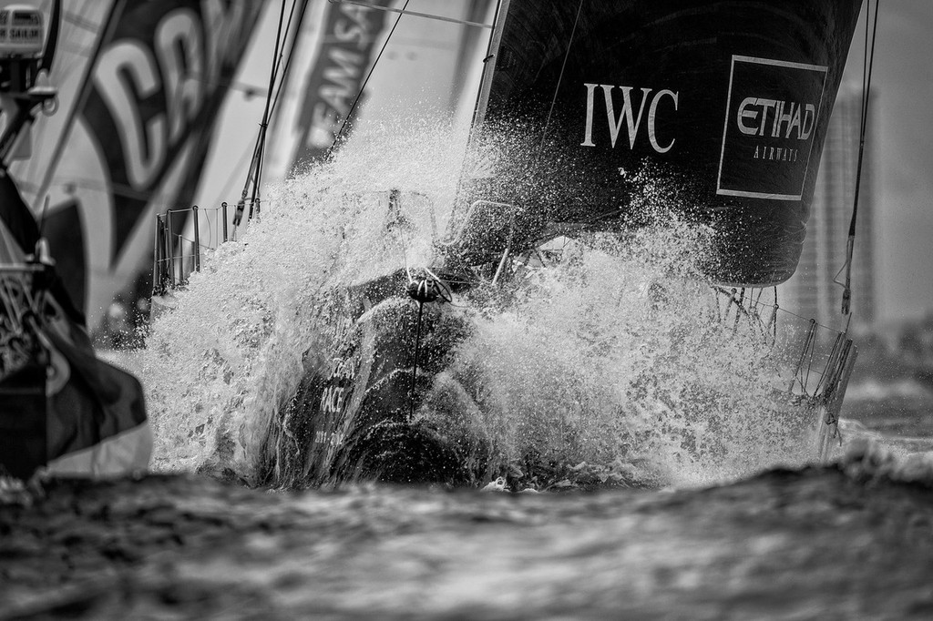 Waves crash over the deck of Abu Dhabi Ocean Racing, skippered by Ian Walker from the UK, during the PORTMIAMI In-Port Race, during the Volvo Ocean Race 2011-12. © Paul Todd/Volvo Ocean Race http://www.volvooceanrace.com