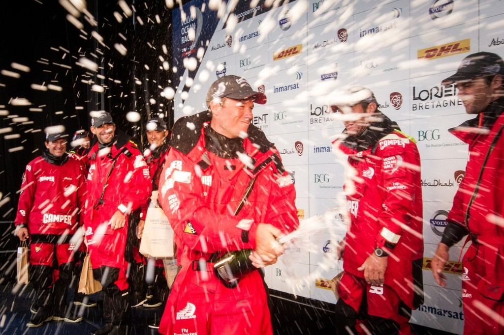 Camper with Emirates Team New Zealand's Nick Burridge from New Zealand sprays champagne, after taking second place on Leg 8 © Ian Roman/Volvo Ocean Race http://www.volvooceanrace.com