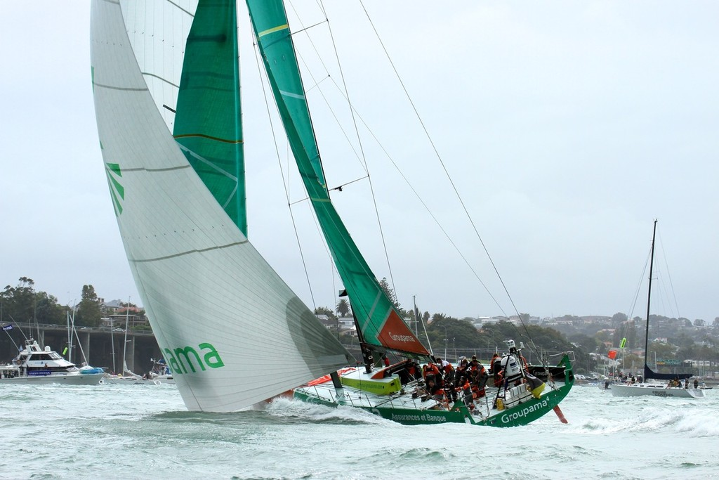 Groupama gets a big tow down to the leeward rounding mark - Volvo Ocean Race Auckland - Start March 18,2012 © Richard Gladwell www.photosport.co.nz