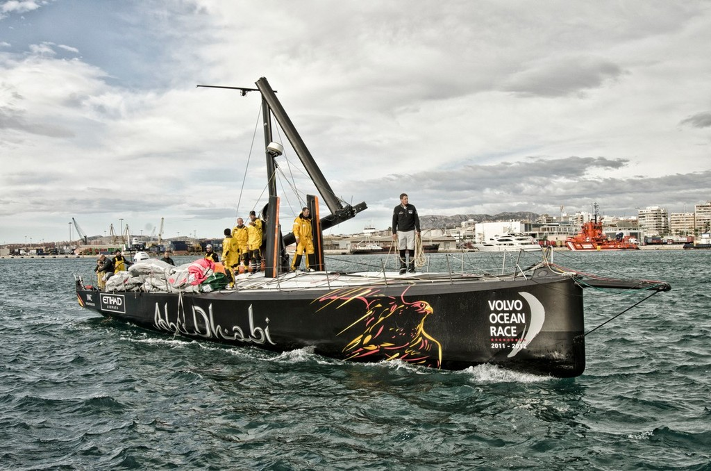 Abu Dhabi Ocean Racing's yacht Azzam, skippered by Britain's Ian Walker, returns to Alicante, Spain after the mast broke in rough weather on the first day of racing on leg 1 of the Volvo Ocean Race 2011-12.  ©  Marc Bow / Volvo Ocean Race