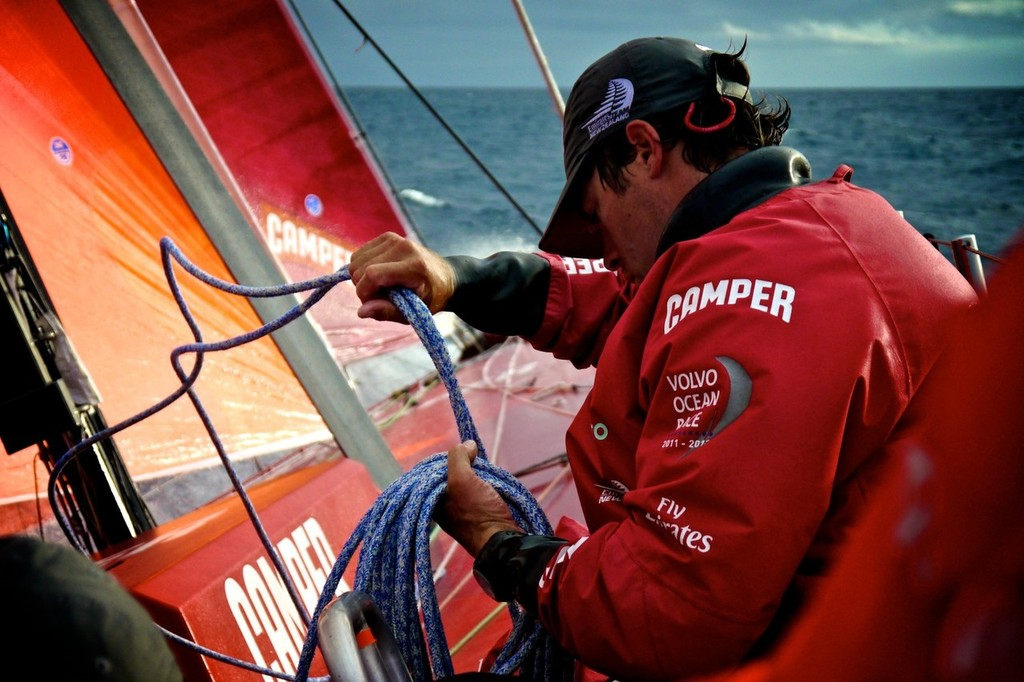 Daryl Wislang coiling the furling line onboard Camper with Emirates Team New Zealand during leg 8 of the Volvo Ocean Race 2011-12, from Lisbon, Portugal to Lorient, France.  © Hamish Hooper/Camper ETNZ/Volvo Ocean Race