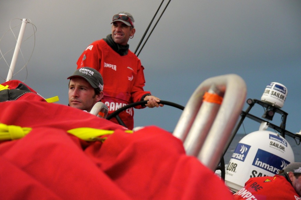 Adam Minoprio trims the main, while Stuart Bannatyne drives, onboard Camper with Emirates Team New Zealand during leg 8 of the Volvo Ocean Race 2011-12, from Lisbon, Portugal to Lorient, France.  © Hamish Hooper/Camper ETNZ/Volvo Ocean Race