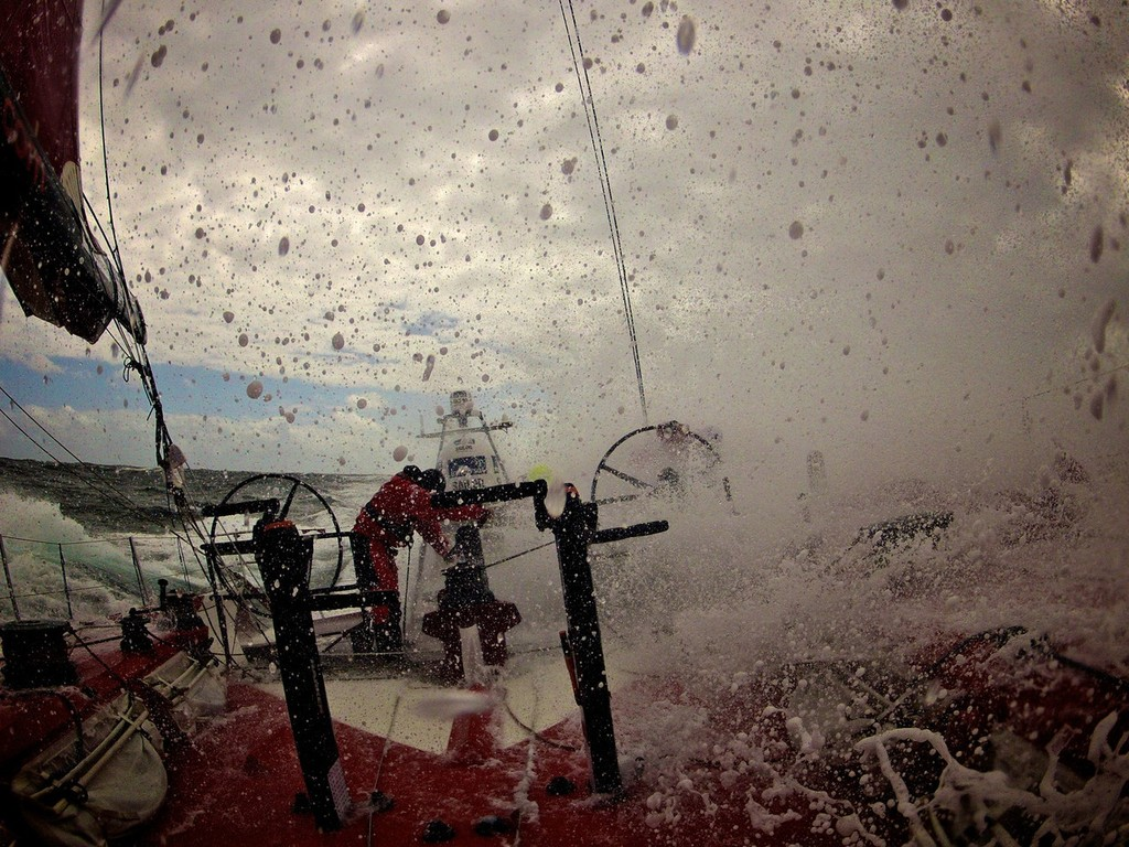 A wave of white water obscures the view of the crew, onboard Camper with Emirates Team New Zealand during Leg 8 of the Volvo Ocean Race 2011-12, from Lisbon, Portugal to Lorient, France.  © Hamish Hooper/Camper ETNZ/Volvo Ocean Race
