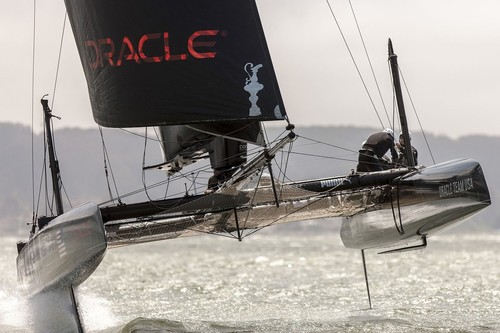 Oracle Team USA foiling in the AC45's in 2012 shows a hoisted L-dagger board, to windward, with the leeward hull fully supported and flying. The T-foil rudder is also evident, just clear of the water on the rear of the windward hull © Guilain Grenier Oracle Team USA http://www.oracleteamusamedia.com/